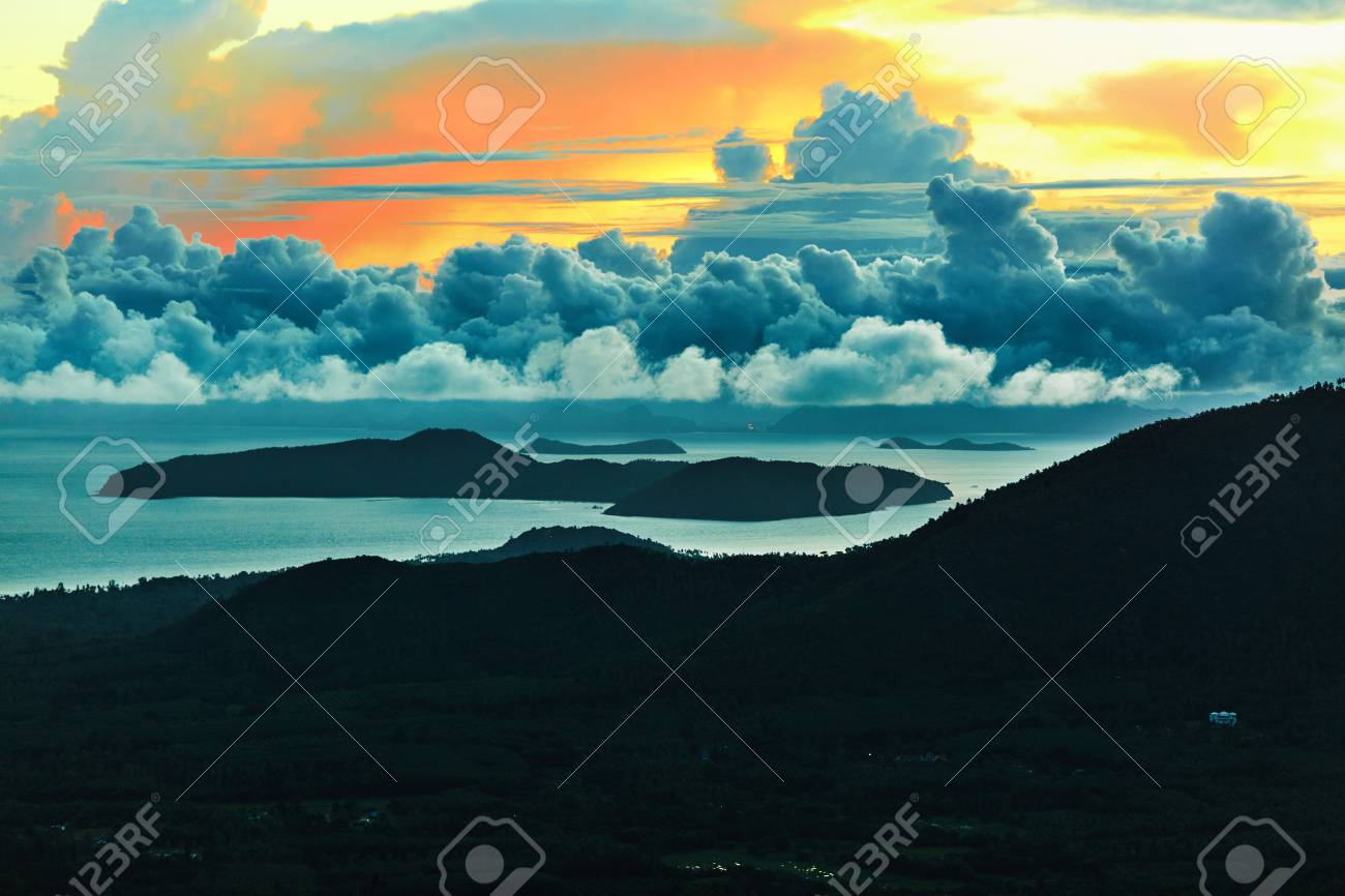 Scenic View Landscape Of Paradise Island During Sunset Or Sunrise Over The  Sea - Nature Background. Scenic View Landscape Of Paradise Island During