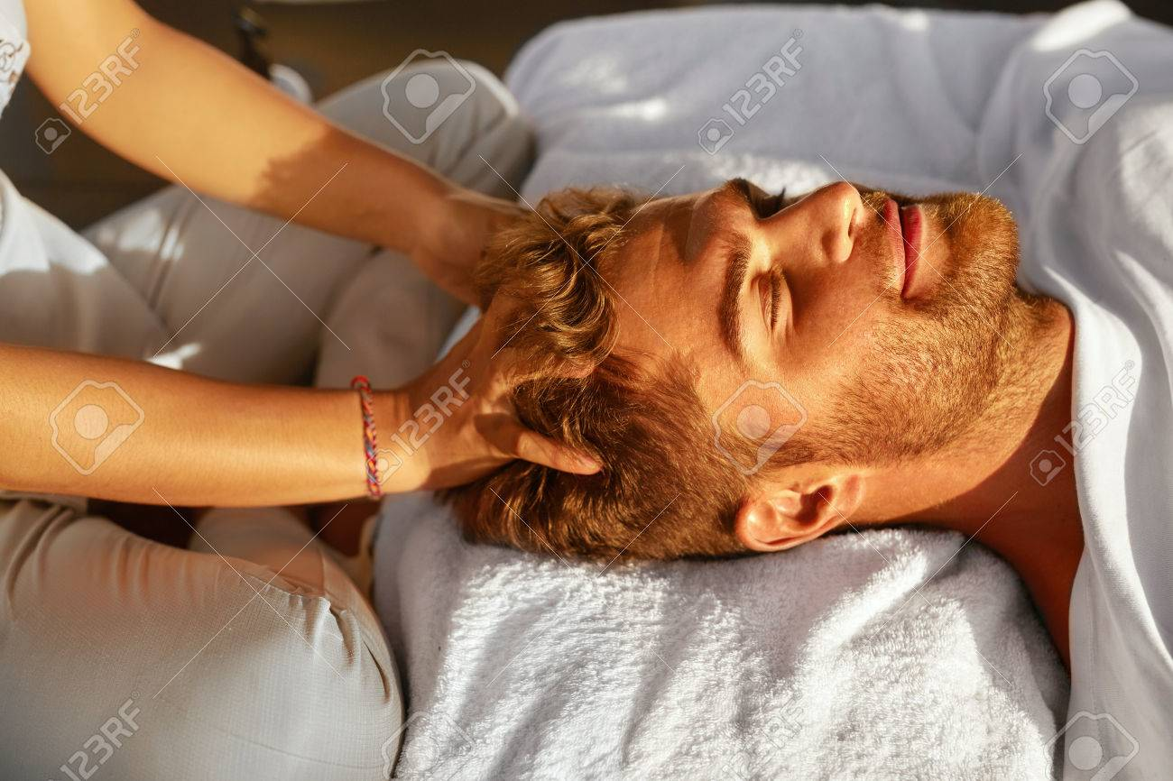 Spa Massage. Closeup Of Beautiful Healthy Happy Man Enjoying Relaxing Head Massage At Outdoor Day Salon. Masseur Hands Massaging Handsome Male Head. Relax Beauty Treatment For Men, Health Care Concept - 57959149
