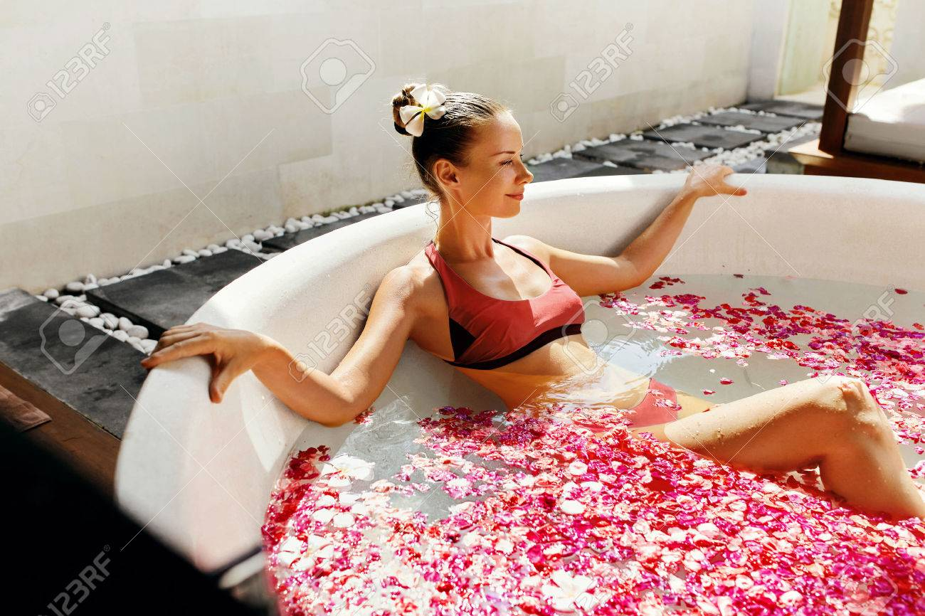 73357266bd7b6 Stock Photo - Woman In Bath At Day Spa Salon. Beautiful Smiling Girl In Bikini  Bathing