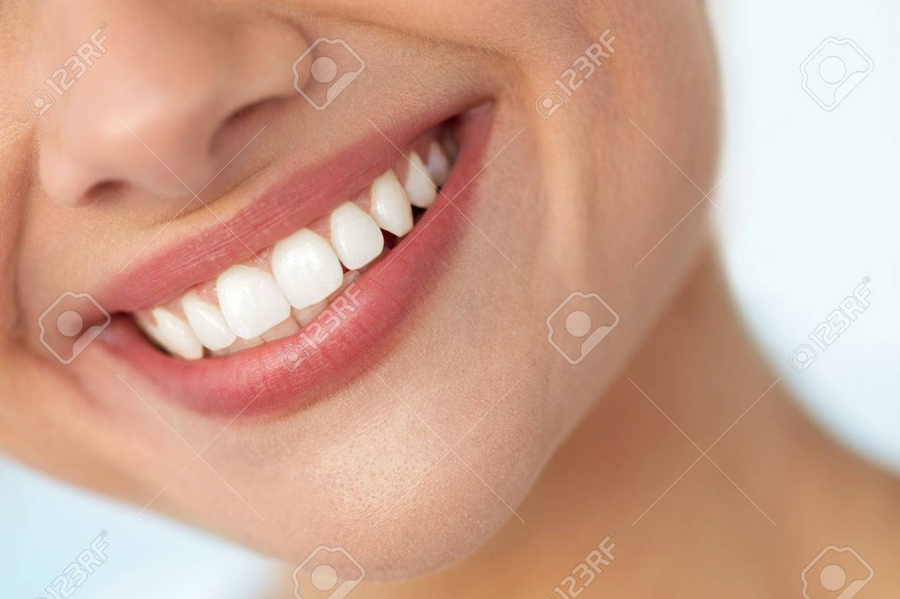 Beautiful Smile With White Teeth. Closeup Of Smiling Woman Mouth With Natural Plump Full Lips And Healthy Perfect Smile. Teeth Whitening, Dental Health And Lip Care Concepts. High Resolution Image - 61732304