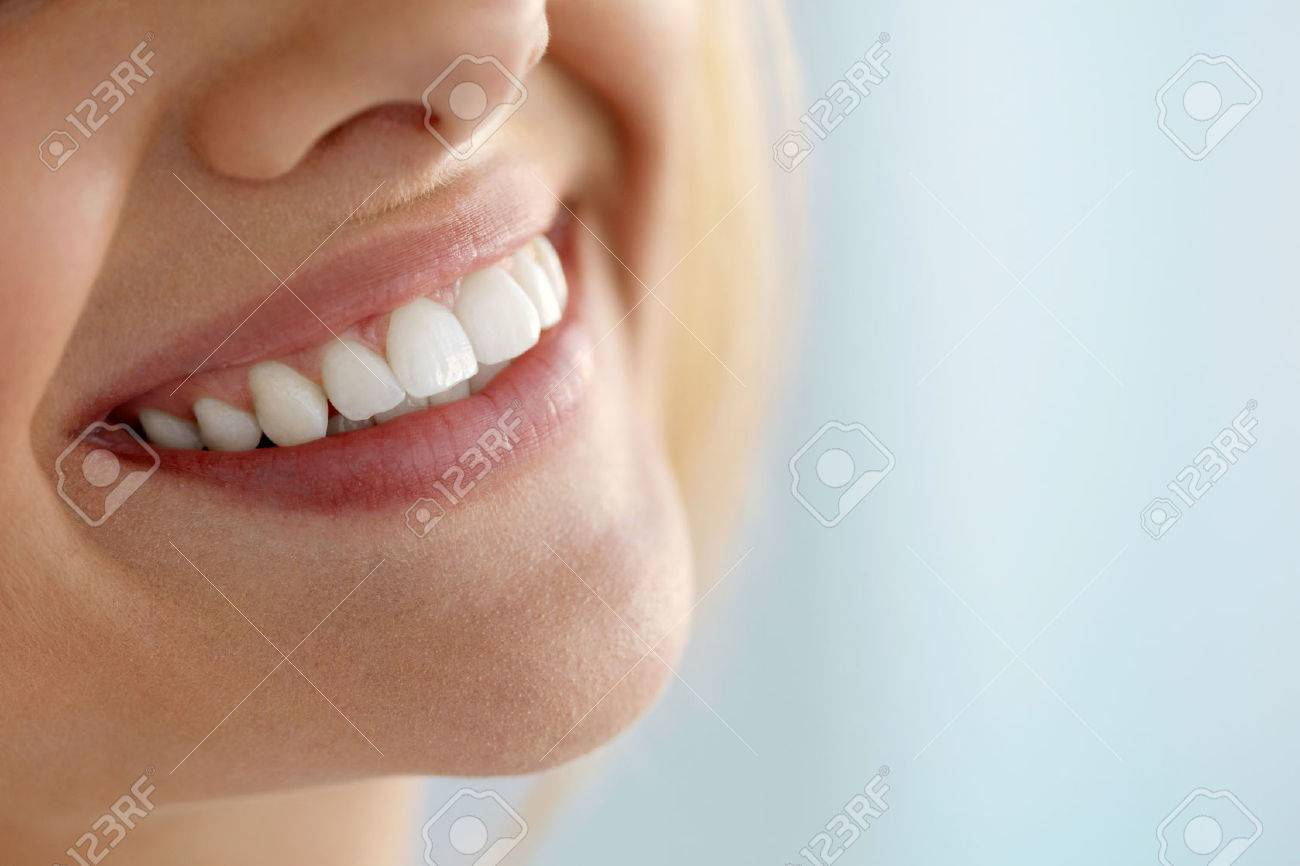 Beautiful Smile With White Teeth. Closeup Of Smiling Woman Mouth With Natural Plump Full Lips And Healthy Perfect Smile. Teeth Whitening, Dental Health And Lip Care Concepts. High Resolution Image - 61732727