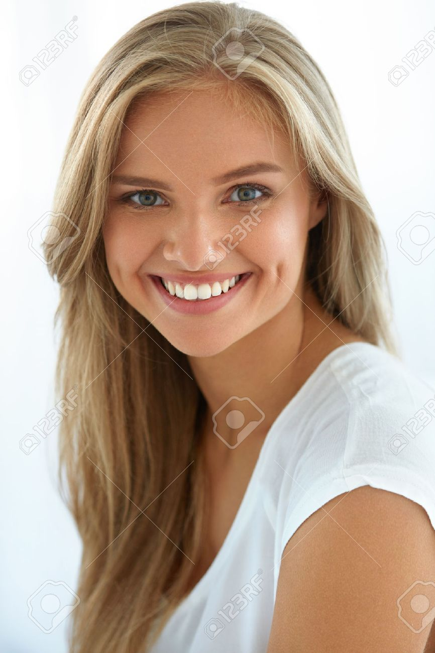 Closeup Of Beautiful Happy Girl With Perfect Smile White Teeth Smiling