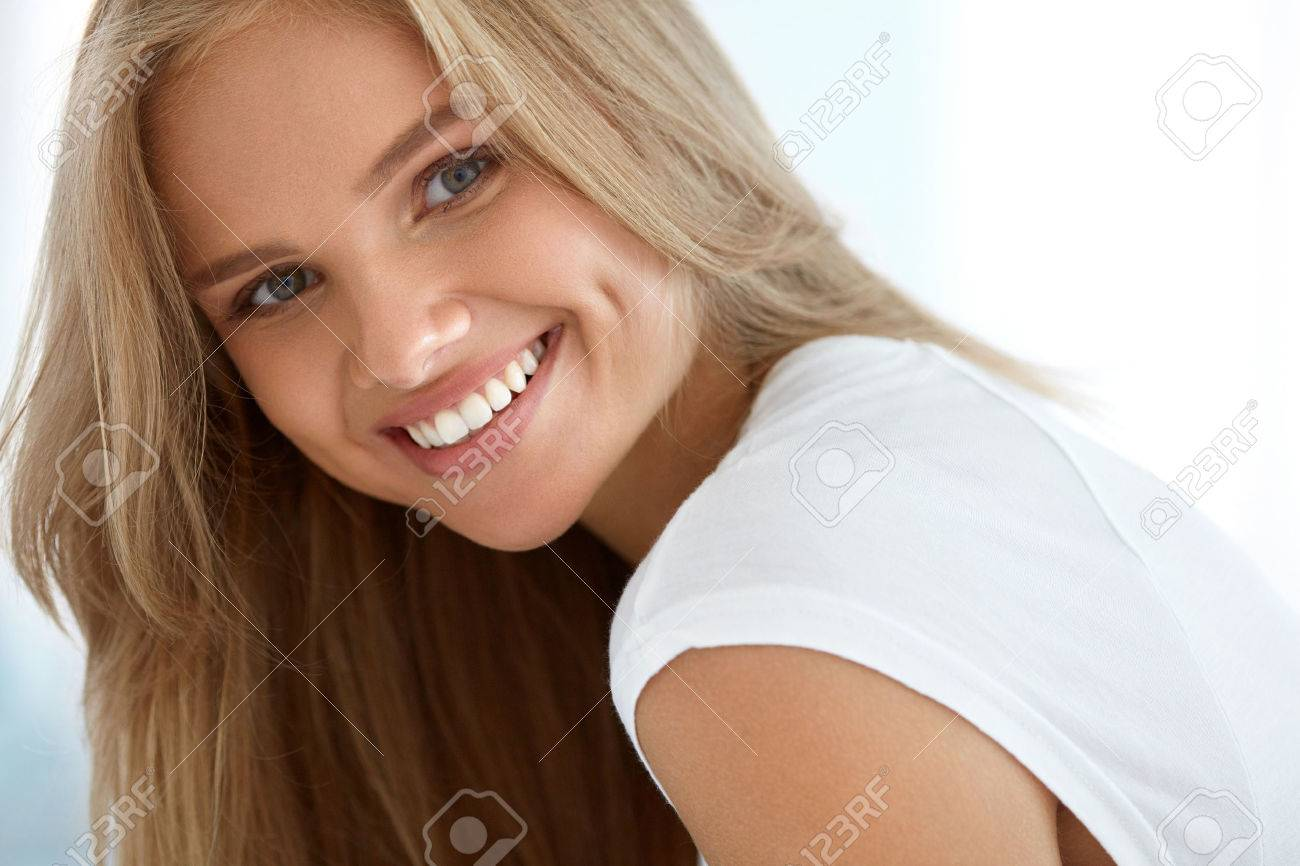 Beauty Woman Portrait. Closeup Of Beautiful Happy Girl With Perfect Smile, White Teeth Smiling At Camera. Attractive Healthy Young Female With Fresh Natural Face Makeup Indoors. High Resolution Image - 61732744