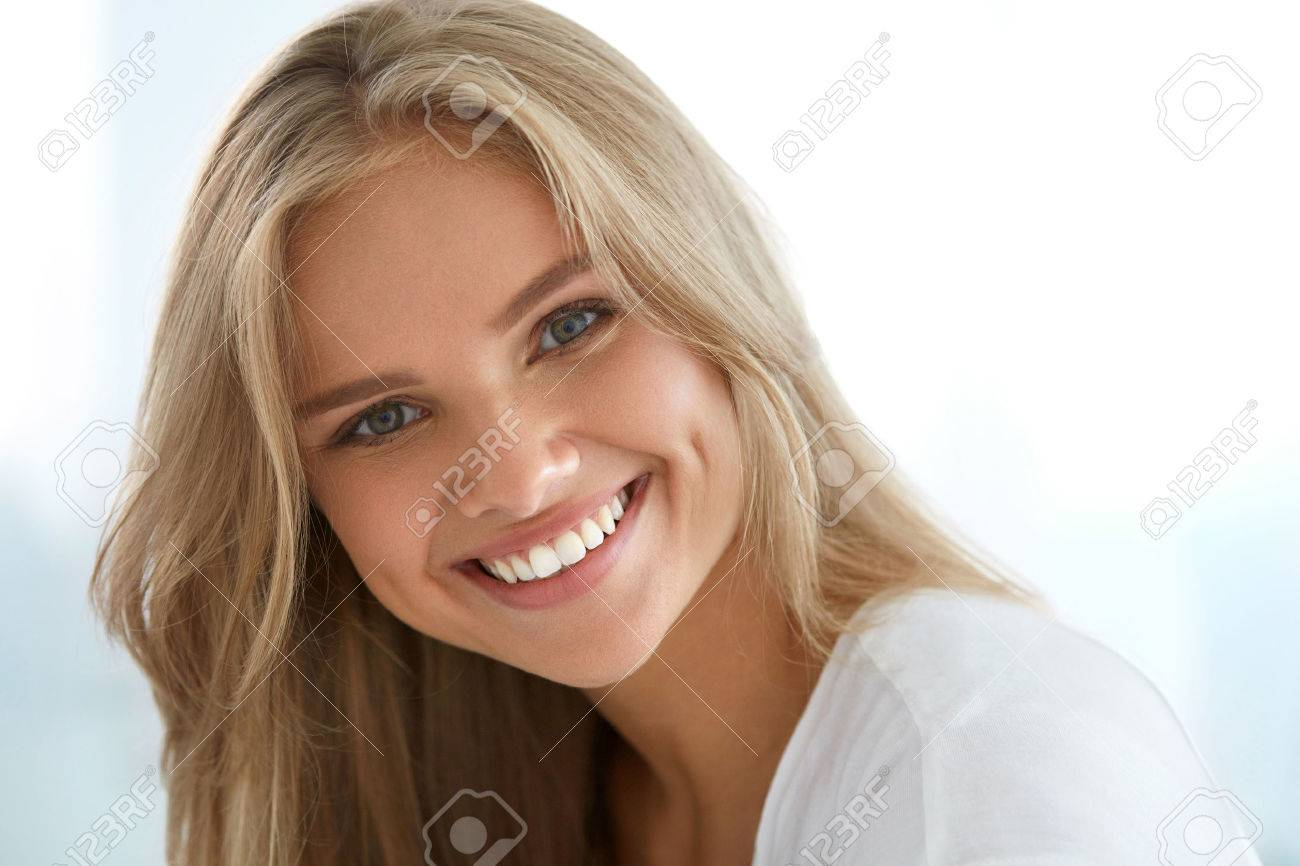 Beauty woman portrait closeup of beautiful happy girl with perfect smile white teeth smiling