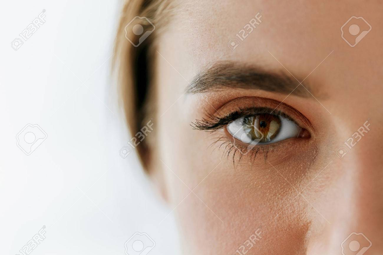 Eye Health And Care. Closeup Of Beautiful Woman Big Brown Eye And Eyebrow. Girl Eye Smooth Healthy Skin And Perfect Natural Makeup On White Background. High Resolution Image - 69164396