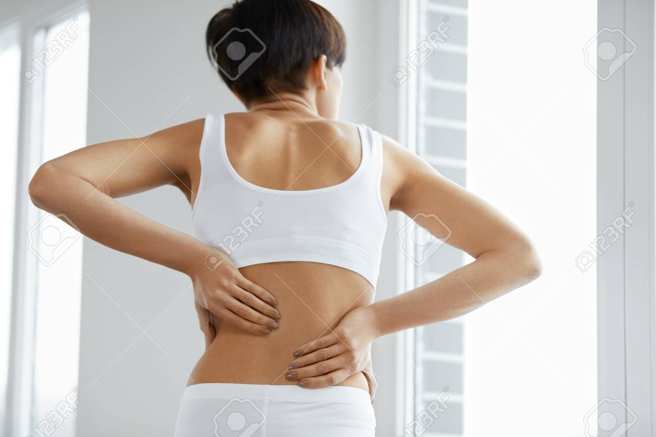 Back Pain Closeup Of Beautiful Woman Having Spinal Or Kidney Stock Photo Picture And Royalty Free Image Image 69606601