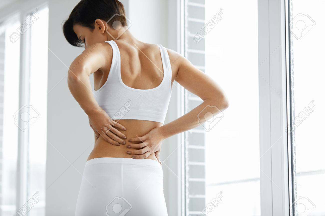 Back Pain Closeup Of Beautiful Woman Having Spinal Or Kidney Stock Photo Picture And Royalty Free Image Image 69605114