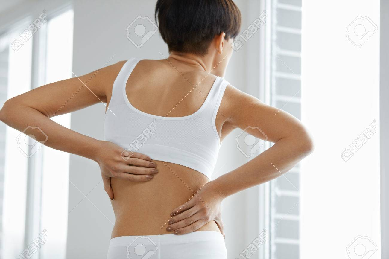 Back Pain Closeup Of Beautiful Woman Having Spinal Or Kidney Stock Photo Picture And Royalty Free Image Image 69605200