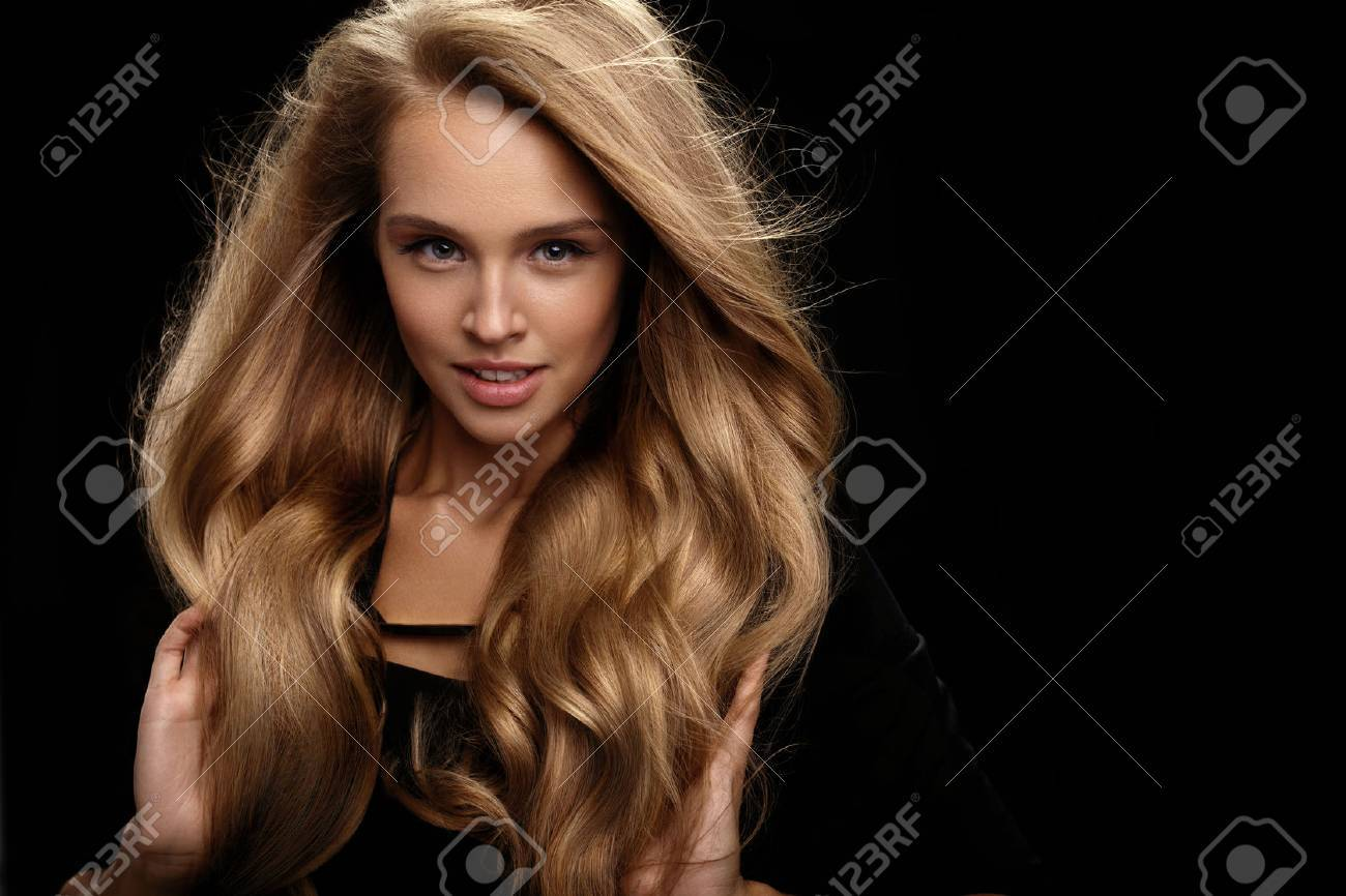 volume hairstyle big stock photo volume hair beautiful woman with beauty face perfect makeup healthy shiny wavy long hair on black background sexy model girl fashion makeup