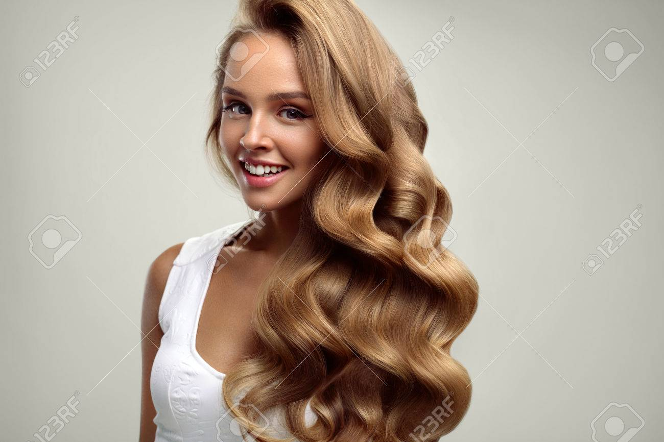 Hair Beauty Beautiful Woman With Healthy Long Shiny Blonde Wavy Curly On White Background