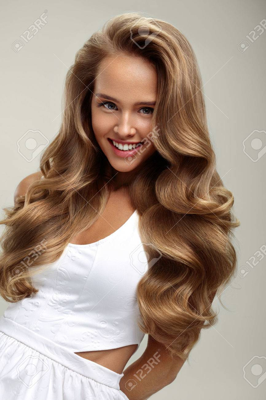 Perfect Hair Beautiful Smiling Woman Model With Long Shiny Blonde