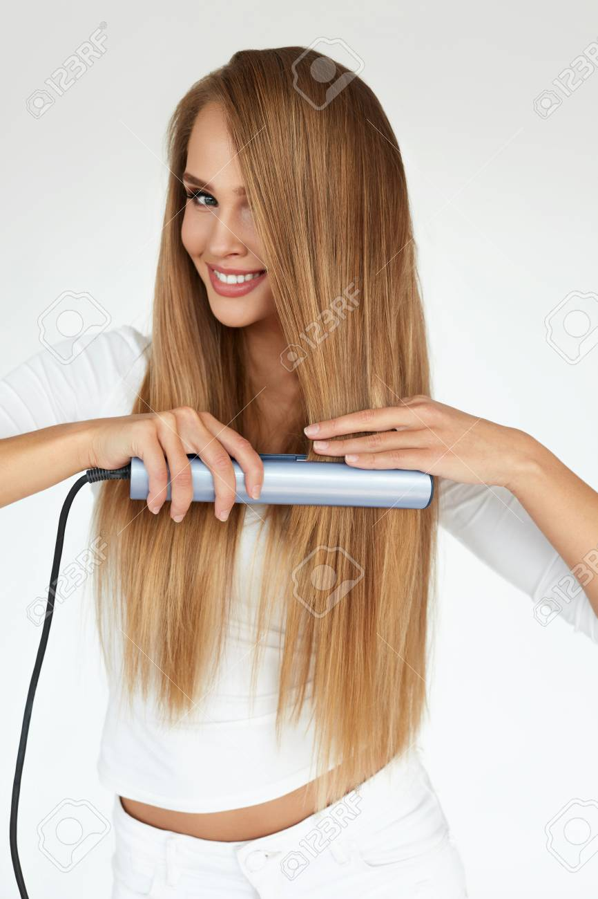Frisur Schone Lachelnde Frau Bugeln Lange Blonde Haare Mit Flachen