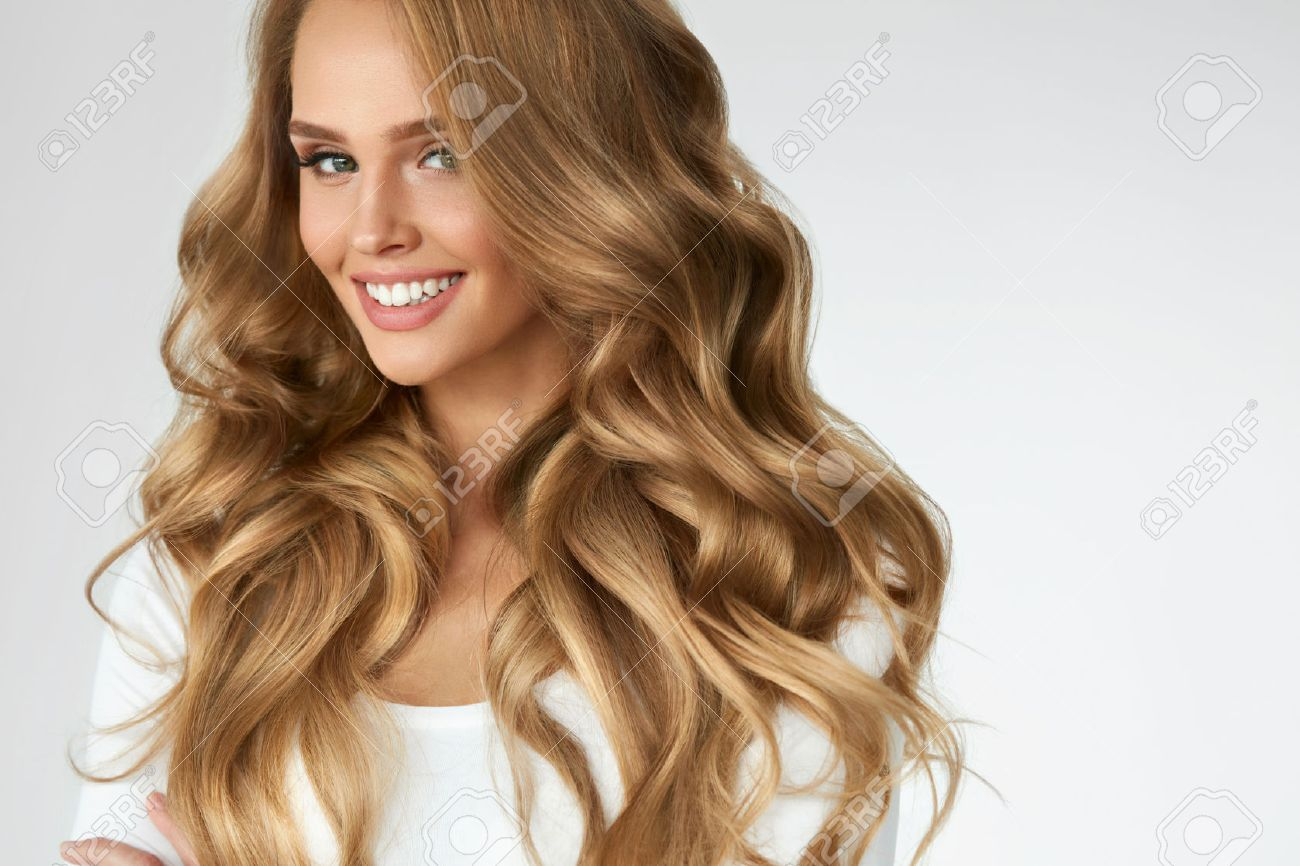 Beautiful Curly Hair Smiling Girl With Healthy Wavy Long Blonde
