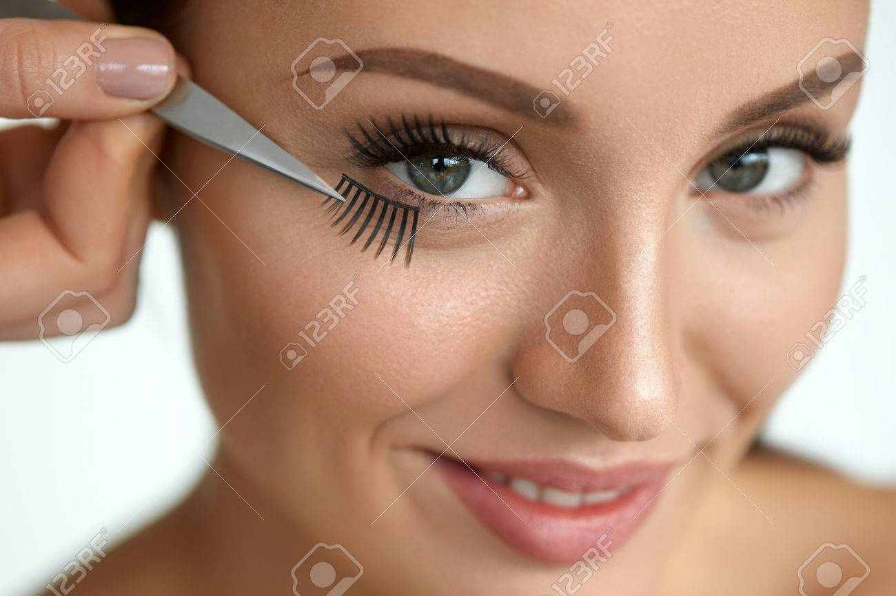 Fake Eyelashes Hand With Tweezers Applying Artificial Eyelashes