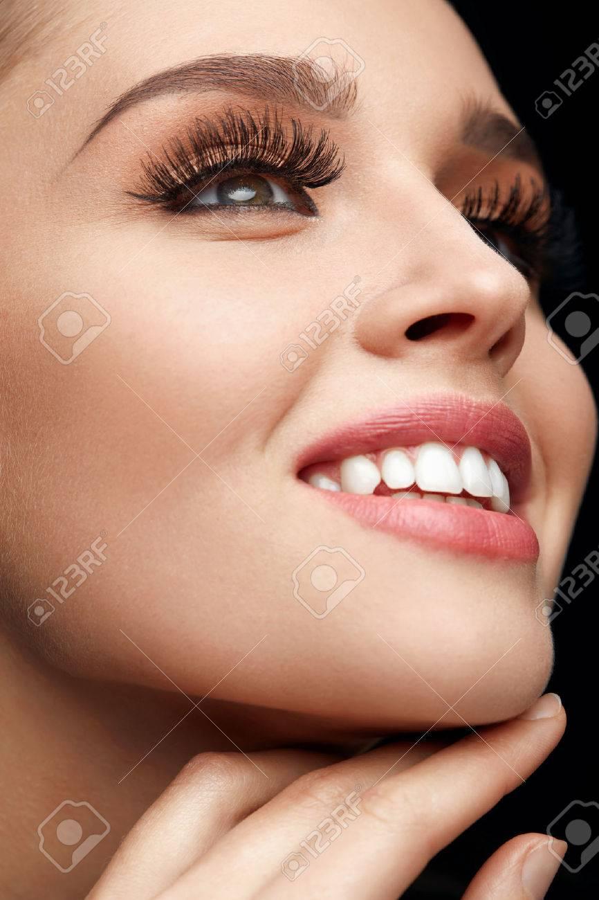 Woman Facial Makeup  Closeup Of Beautiful Smiling Female Face
