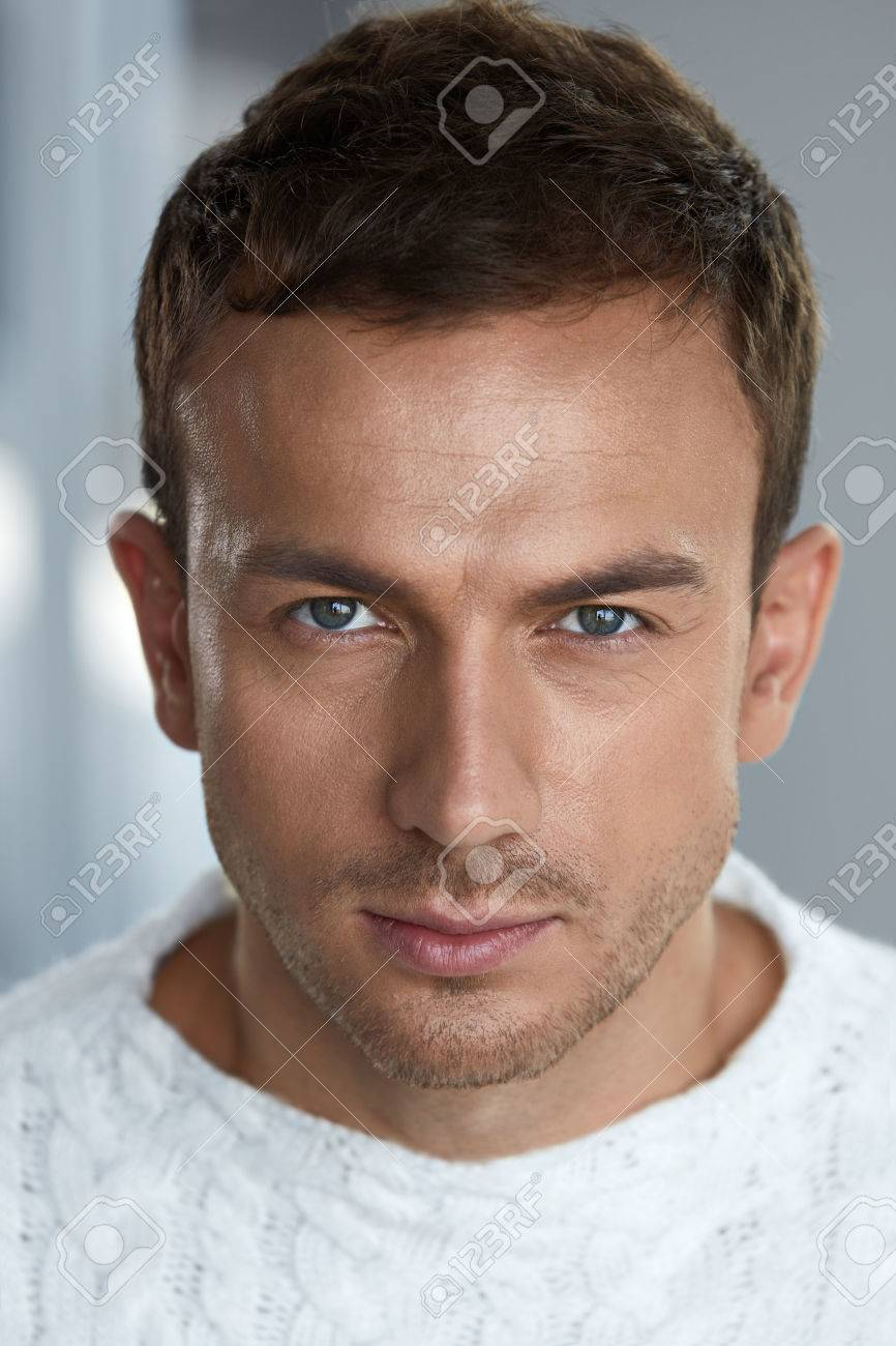 Man beauty handsome young man with beautiful face healthy soft facial skin and stubble