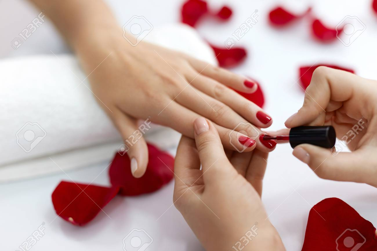 Manicure. Closeup Of Beautiful Woman Hands Polishing Nails With ...
