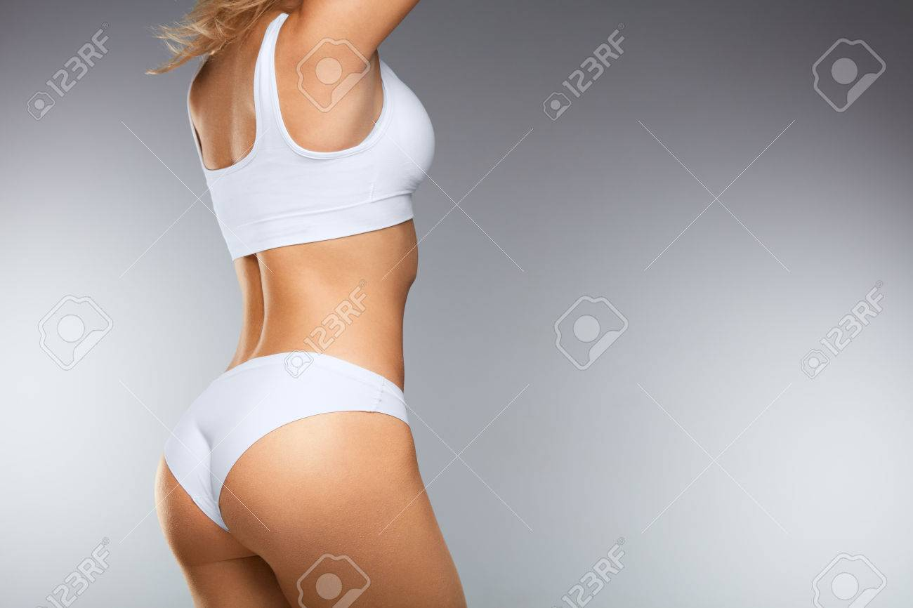 Beautiful Woman Body In Shape. ?loseup Healthy Girl With Fit Slim Body, Soft Skin And Firm Buttocks, Hips In White Bikini Panties. Female With Sexy Back, Tight Big Butt In Underwear. High Resolution - 74374464