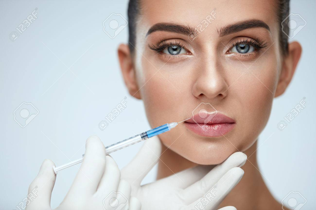 Plastic Surgery  Closeup Of Doctor Hands Doing Beauty Hyaluronic