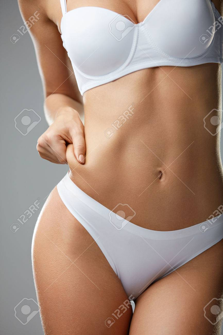 e8256c9063 Stock Photo - Weight Loss Concept. Closeup Of Beautiful Young Woman s Body  With Perfect Body Shape In White Underwear On Grey Background.