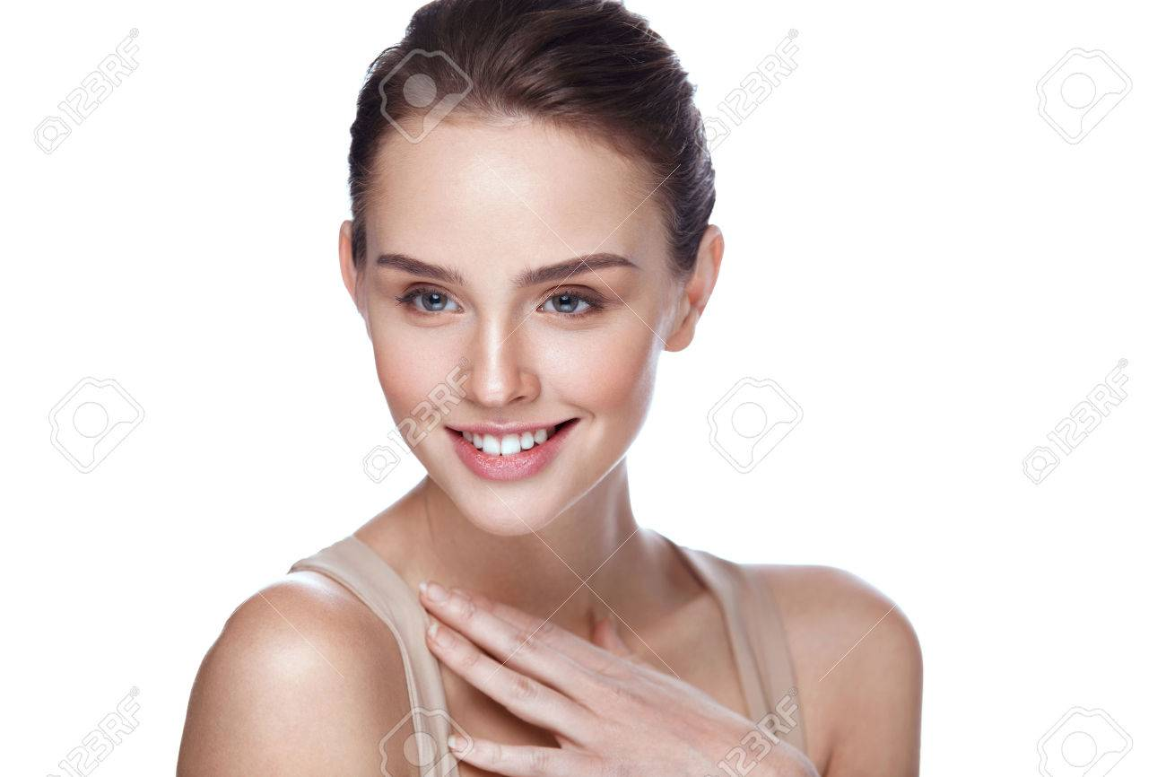 Beauty Cosmetics. Closeup Attractive Young Female Model With Fresh Natural Makeup Touching Her Soft Smooth Pure Skin. Beautiful Smiling Woman Posing On White Background. Skin Care. High Resolution - 76658617
