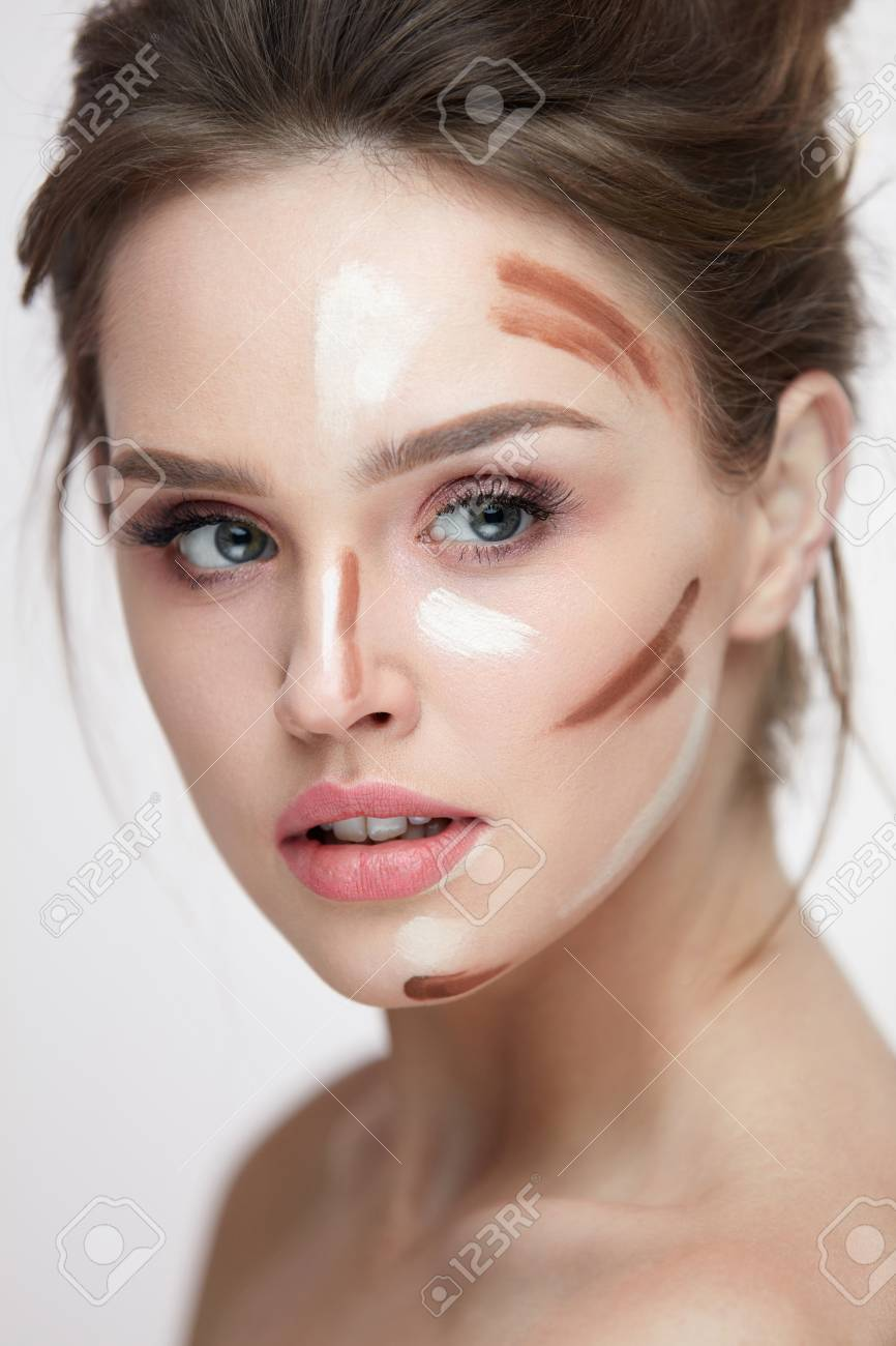 Beauty Cosmetics. Portrait Of Beautiful Sexy Female With Contouring And Highlighting Lines On Facial Skin