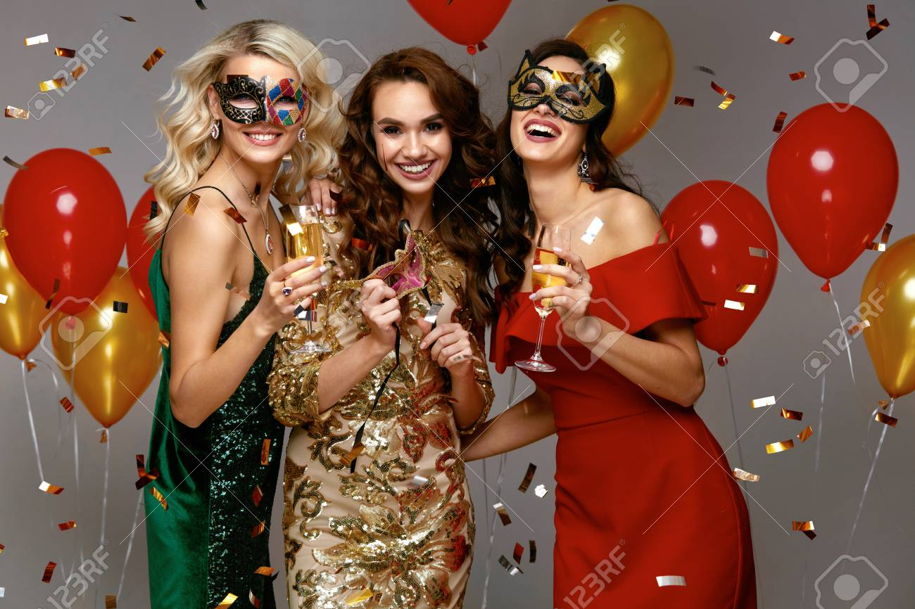 4e3f70c9745 New Year Celebration. Beautiful Girls In Dresses At Party. Portrait Of  Happy Fashionable Women