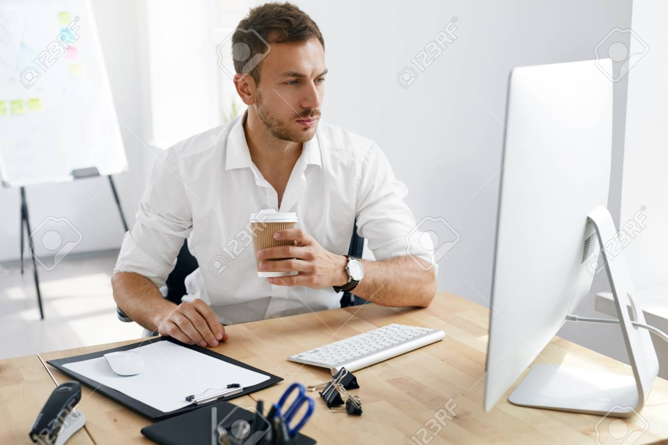 Young Business Man Working On Computer In Office. Portrait Of.. Stock  Photo, Picture And Royalty Free Image. Image 91511117.
