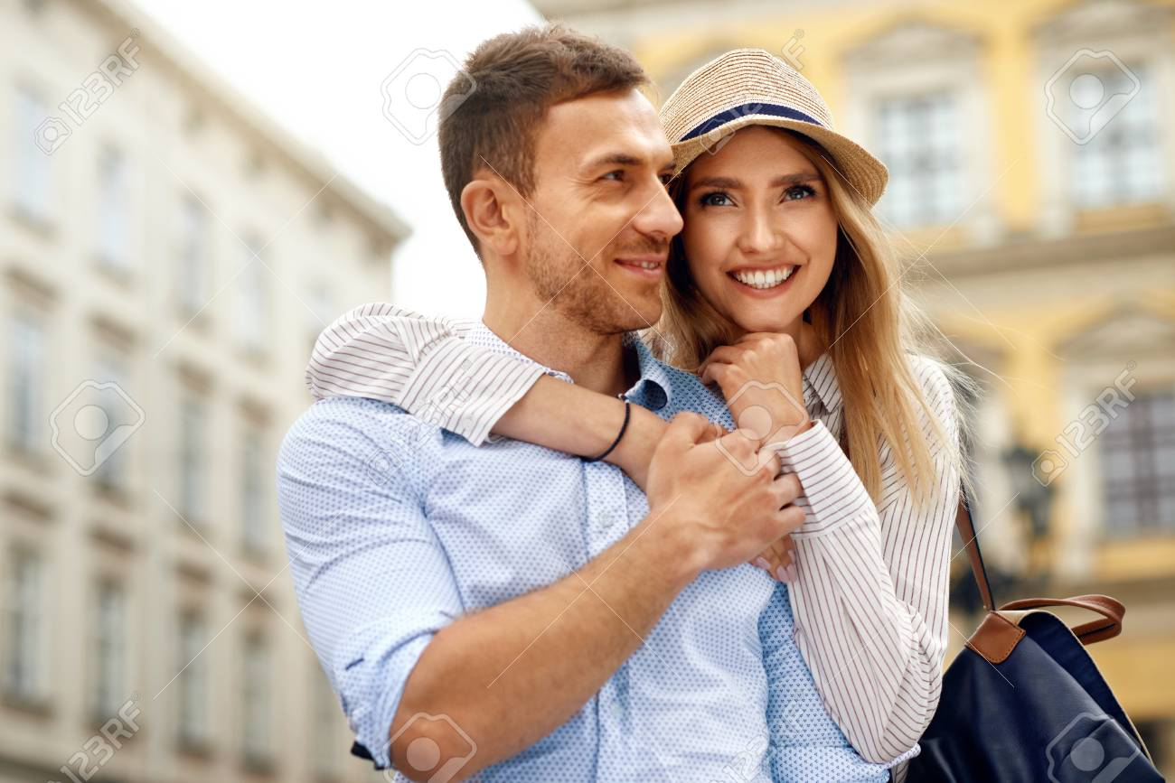 Happy Smiling Couple Together On Street Portrait Of Beautiful