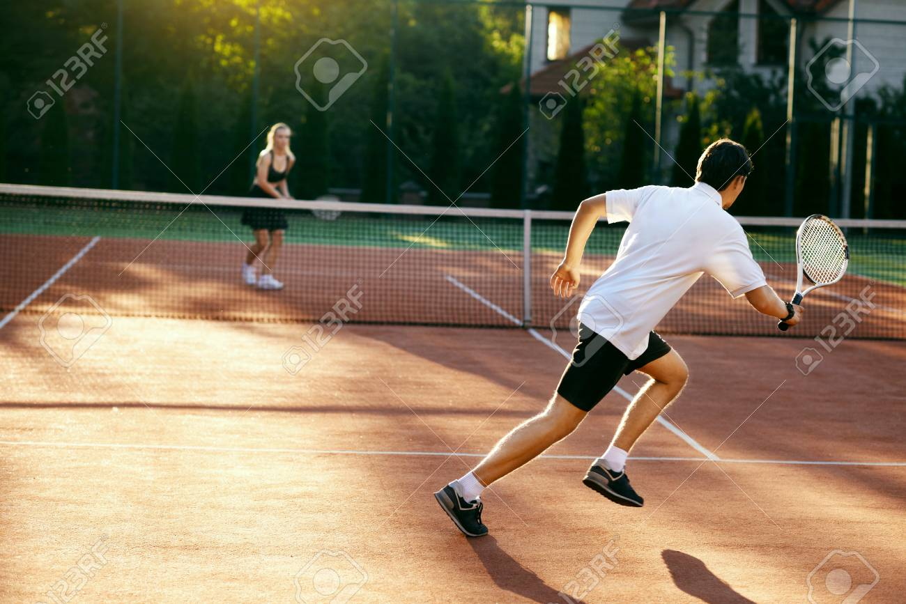 Young People Playing Tennis Outdoors Healthy Active Man And Stock