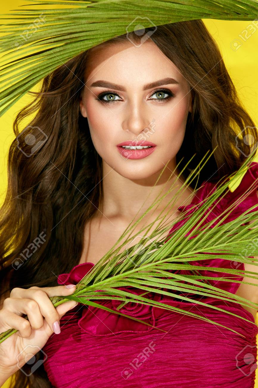 Fashion Makeup. Woman With Beauty Face And Long Curly Hair. Glamorous Sexy Female In Fashionable Dress With Glamour Makeup And Hairstyle On Yellow Background. Summer Fashion. High Quality - 95436251