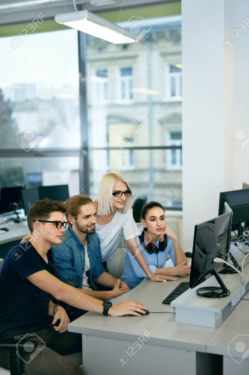 high quality office work. High Quality Image. Team Working In Office. People On Project. Young Beautiful Programmers Typing Data Code Office Work R
