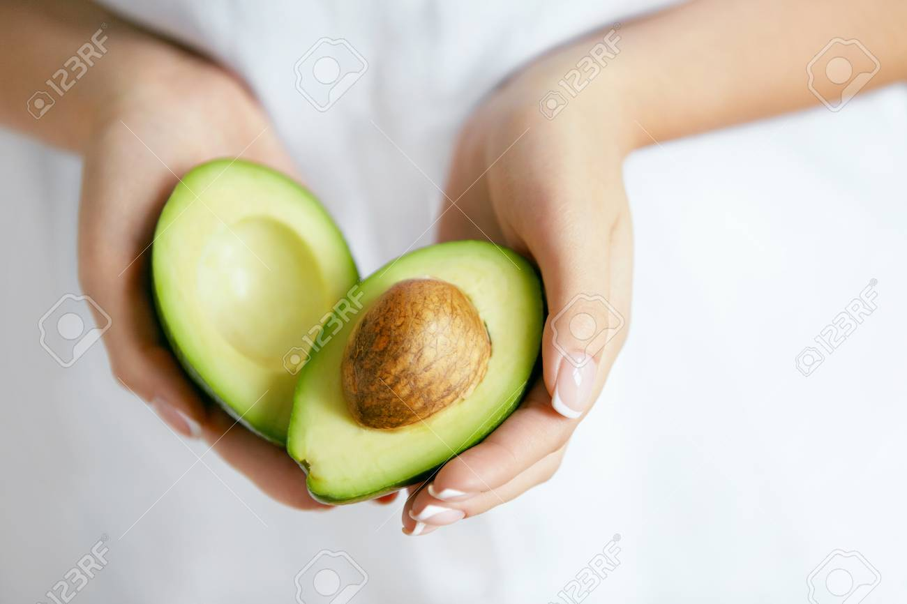 Healthy Food. Avocado In Woman Hands - 96824264