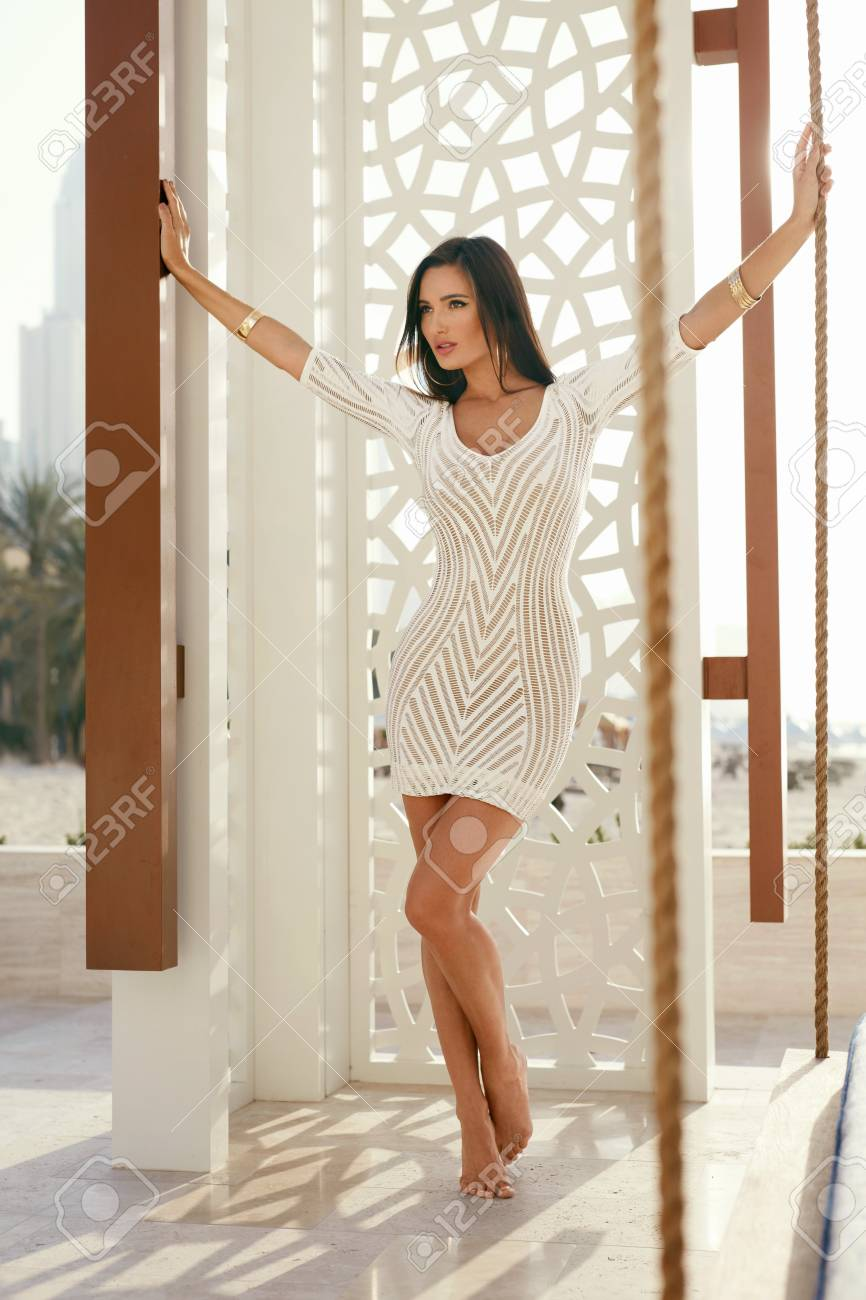 1f109738223 Stock Photo - Women Clothes. Fashion Woman In Fashionable Dress. Beautiful  Female Model With Sexy Fit Body In Stylish Outfit Posing At Luxury Resort  In ...