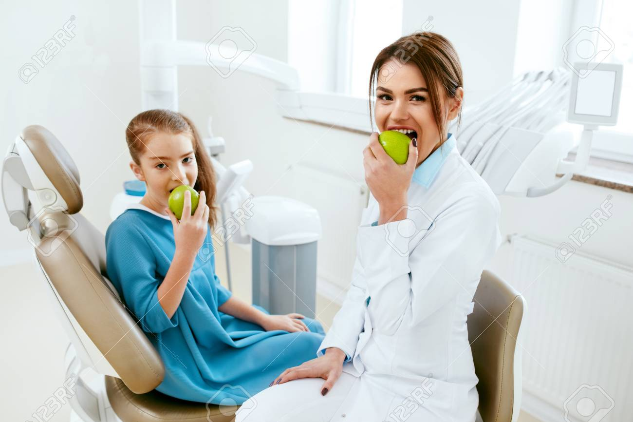 Dental Clinic Female Dentist And Little Patient Eating Green Stock Photo Picture And Royalty Free Image Image 100517599