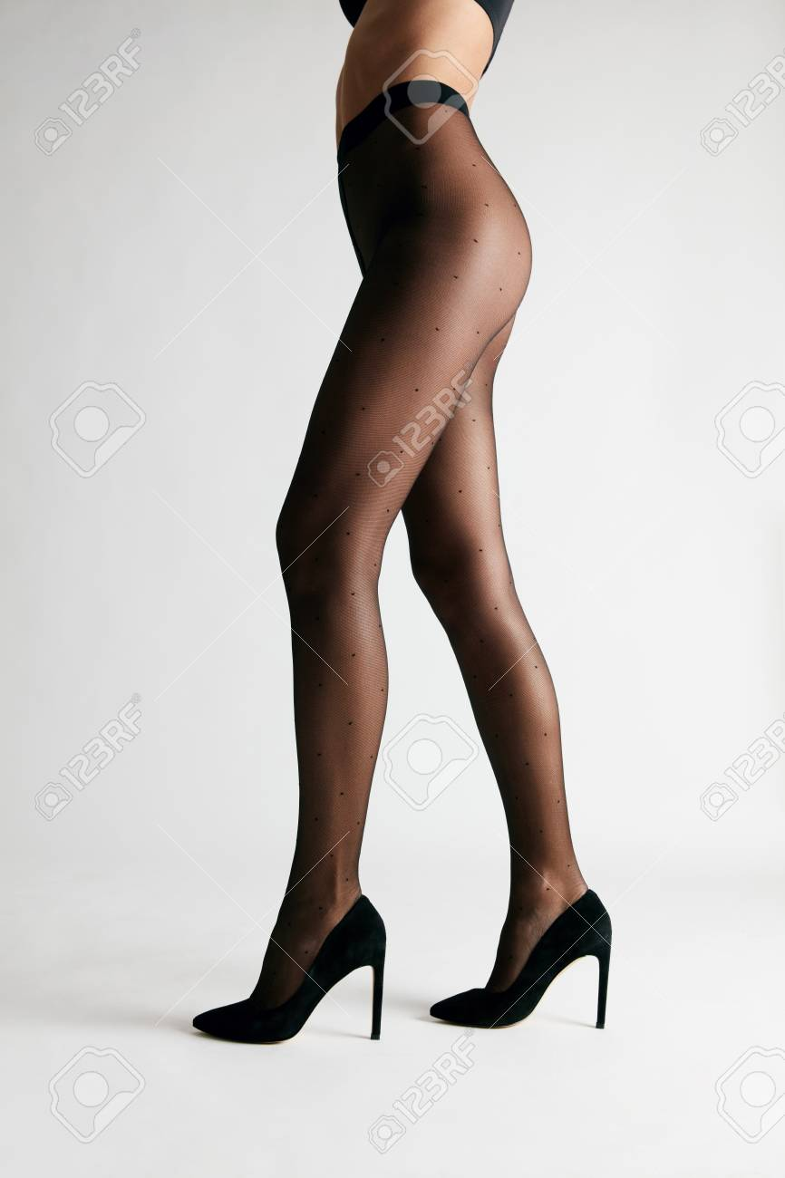 b09d47f66668 Photo black tights female with long legs wearing stylish pantyhose on white  background high resolution jpg