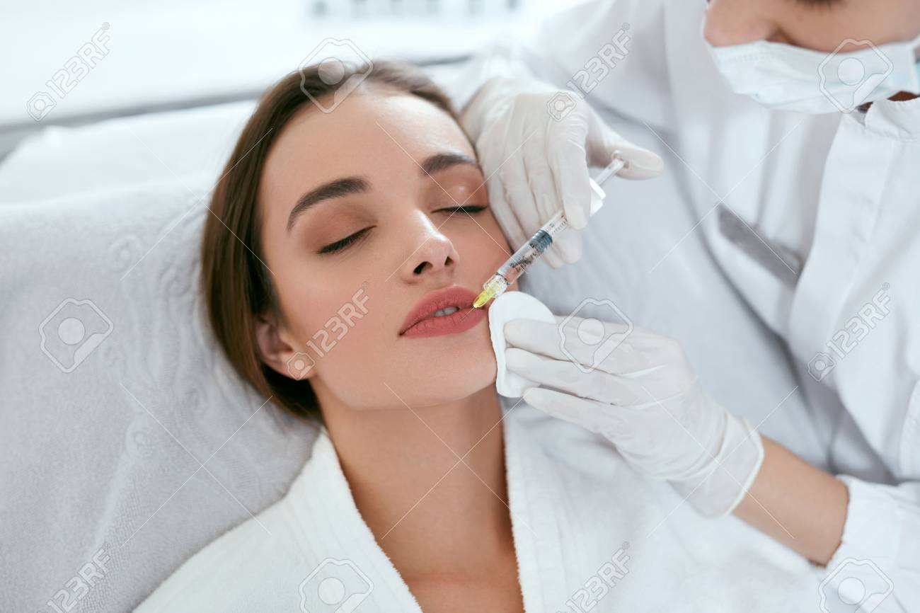 Lip Augmentation. Woman Getting Beauty Injection For Lips, Facial Beauty Procedure. High Resolution - 115069332