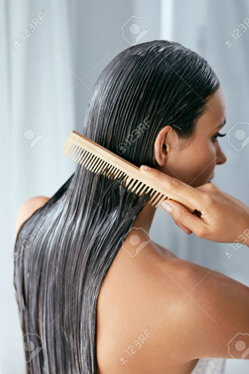 Hair Treatment. Woman With Mask On Wet Hair Closeup, Combing Hair With Wooden Hairbrush. High Resolution - 111009971