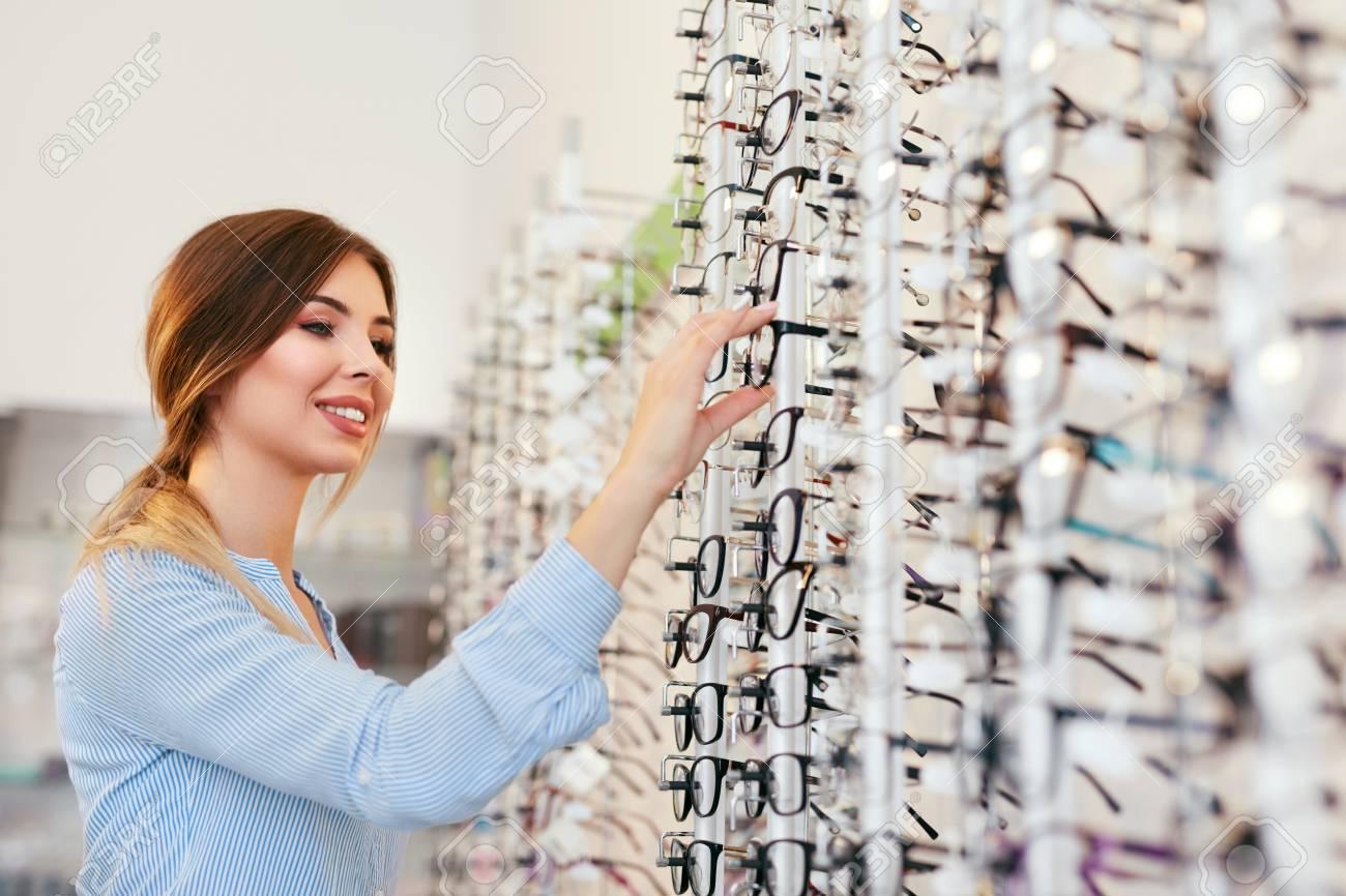 Optical Shop. Woman Near Showcase Looking For Eyeglasses, Choosing Eyewear. High Resolution - 112440557
