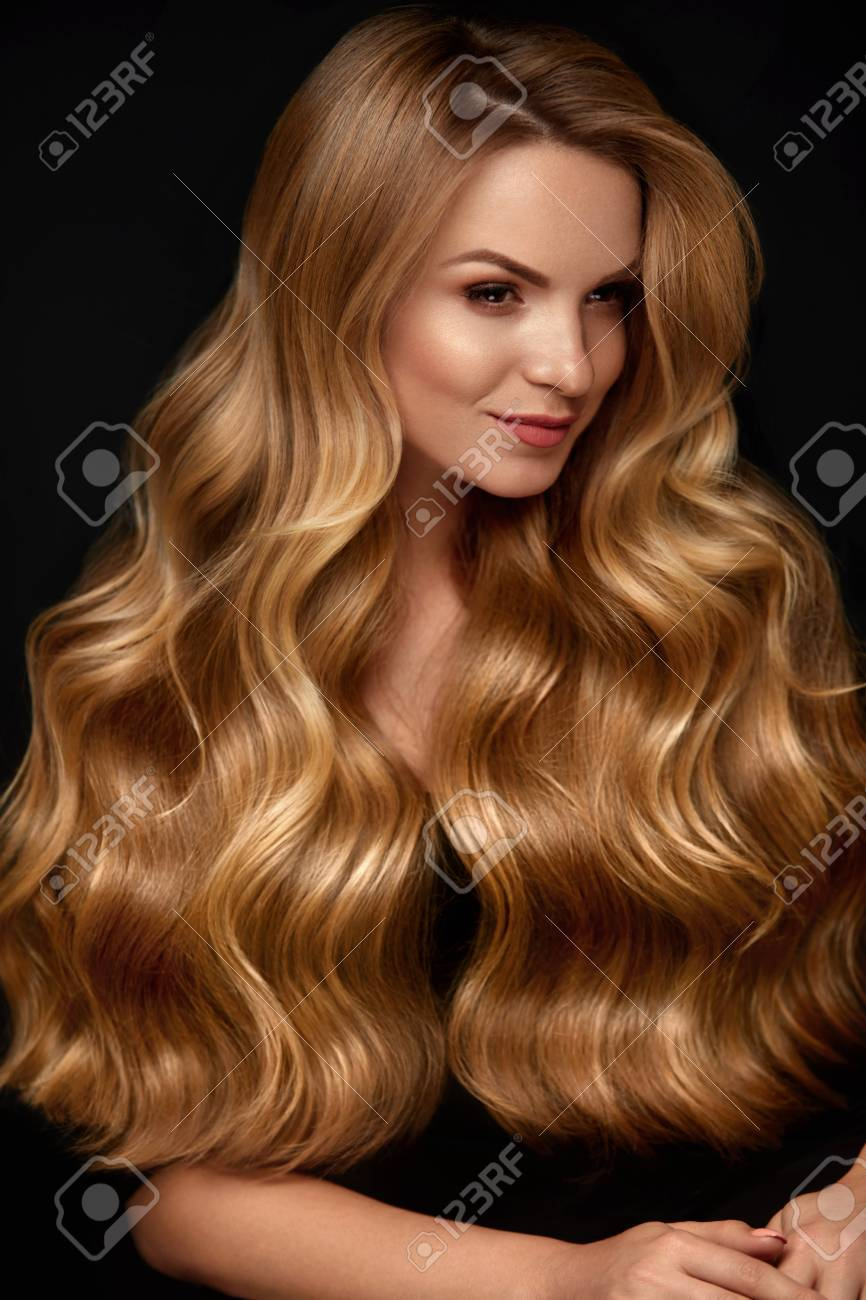 Long Blonde Hair Woman With Wavy Hairstyle And Beauty Face