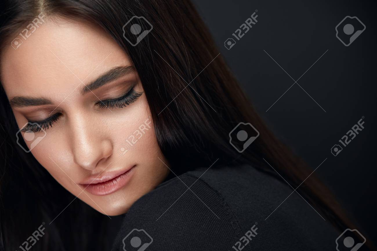 Eyelashes Makeup. Woman Beauty Face With Long Black Lashes Extensions And Beautiful Makeup On Black. High Resolution - 113204114