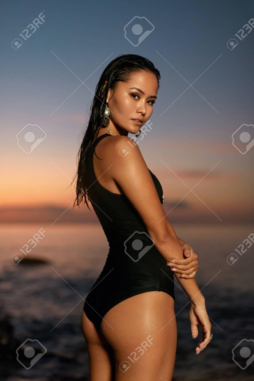 Summer Fashion. Sexy Woman In Black Swimsuit On Sea Coast. Stylish ...