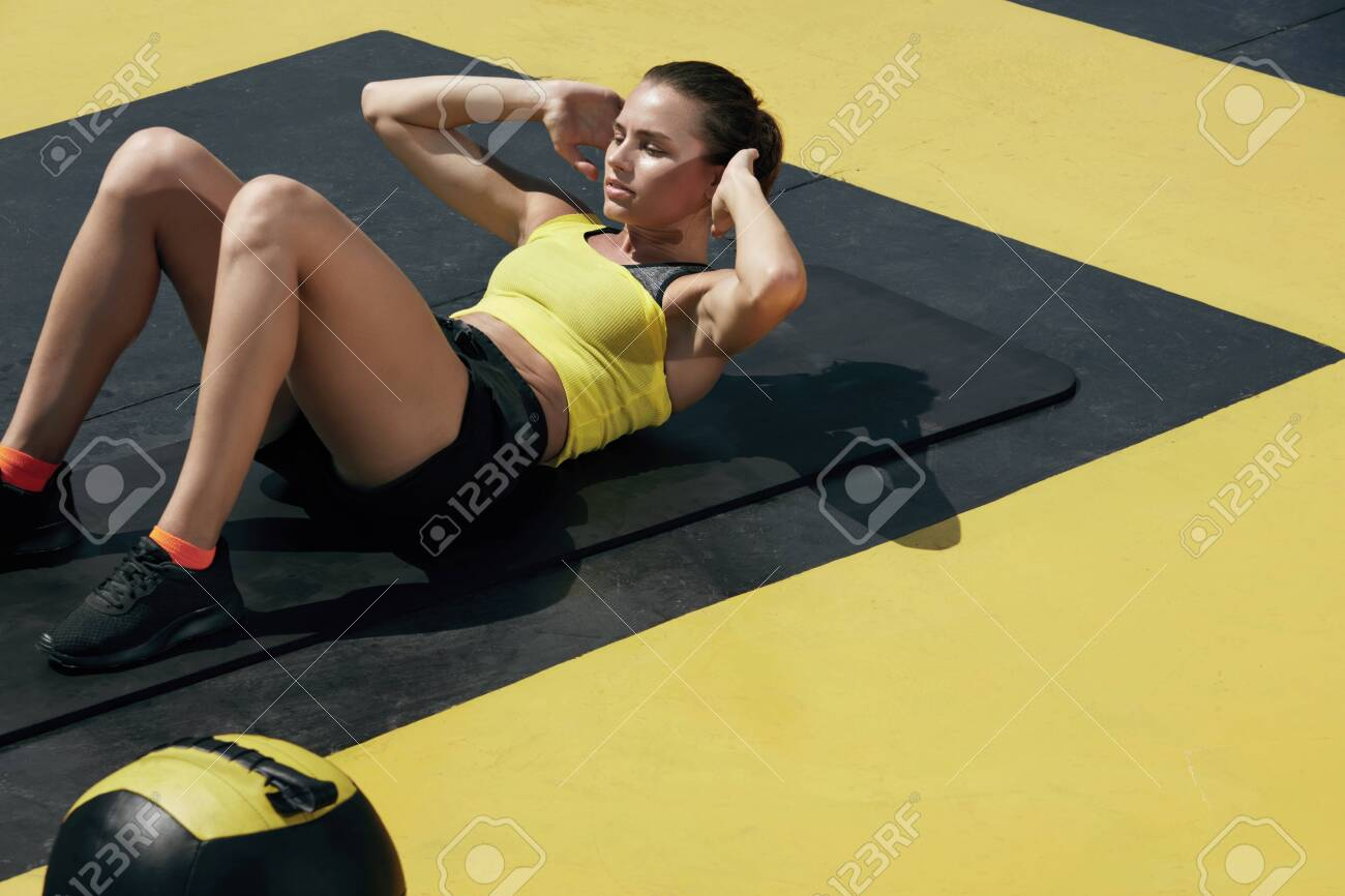 Fitness Woman Doing Sit Ups Exercise Workout At Gym Sport Girl