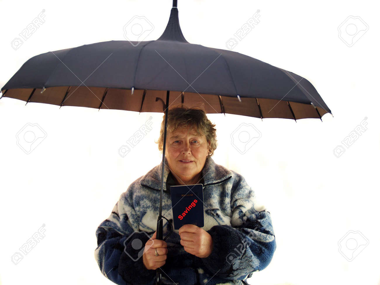 Saving for a rainy day older woman Stock Photo - 663082
