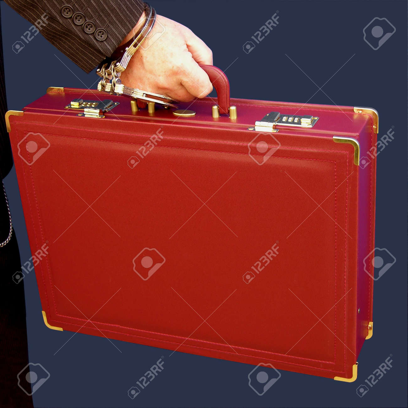 Someone handcuffed to a briefcase for security Stock Photo - 2146838