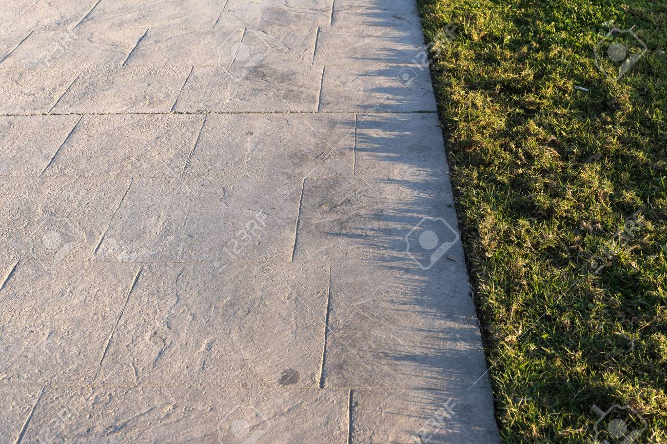 Stamped Concrete Pavement Outdoor With An Expansion Joint At Top, Decorative  Appearance Colors And Textures
