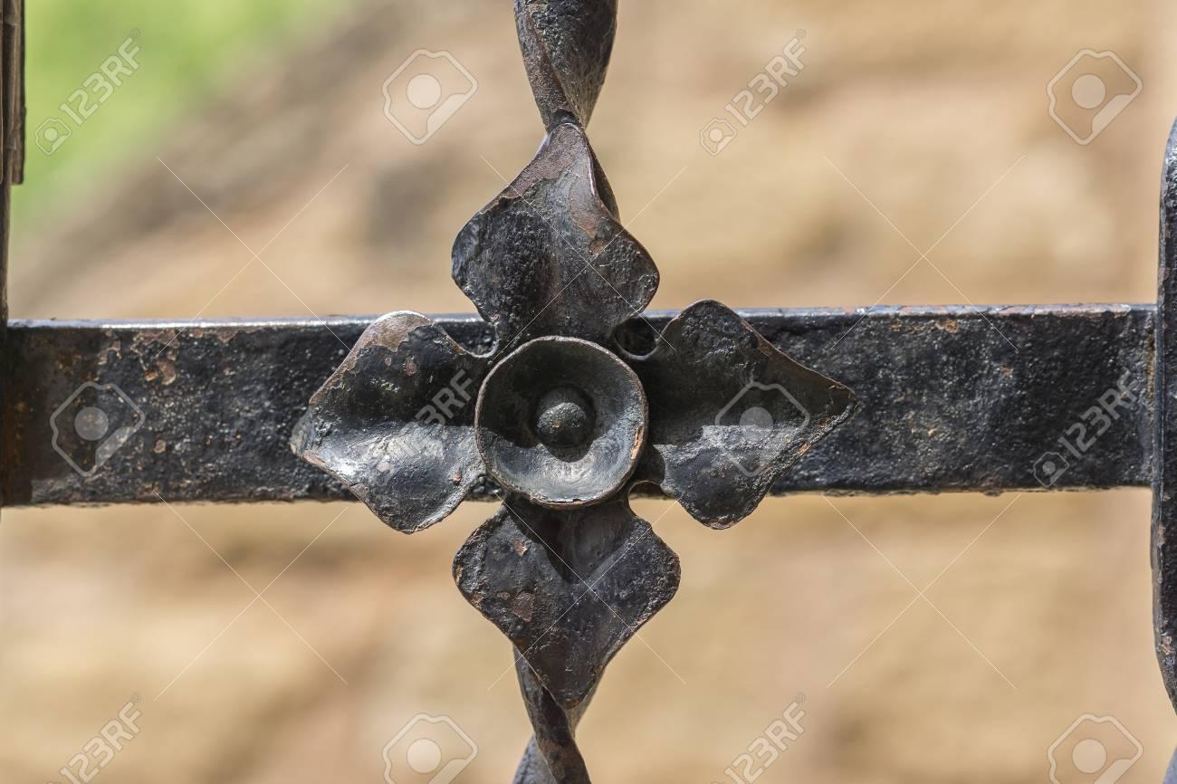 c67a17c360f rustic metal flower artwork in wrought iron ornament Closeup iron lattice  decorations vintage Stock Photo -
