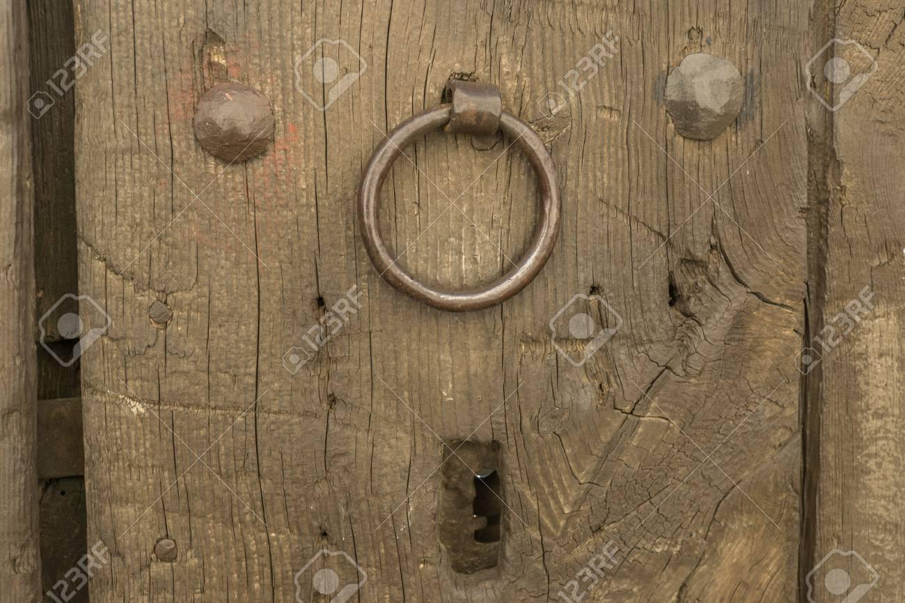 Closeup Vintage Door Lock Of External Antique Wooden Door With A Door  Knocker, Weathered On