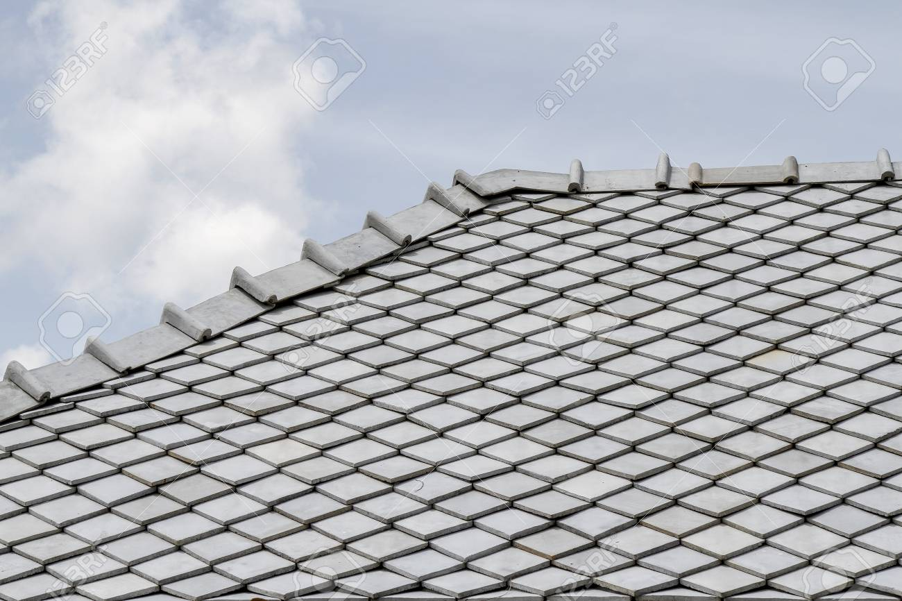 the gray roof and sky in thailand - 125374236