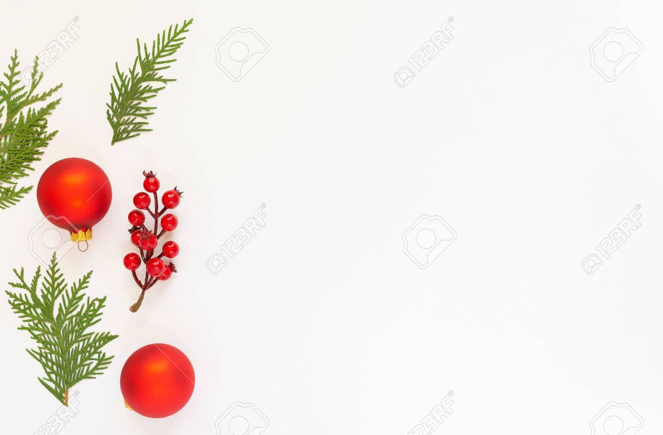 Festive background, branch of hawthorn and Christmas tree balls with fir twigs on a white background, flat lay, top view, copy space - 136311621